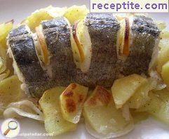 Hake with potatoes in the oven