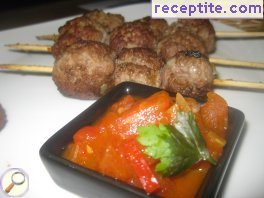 Meatballs on skewers with tomato sauce