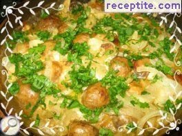 Marinated chicken legs with processed cheese and mushrooms