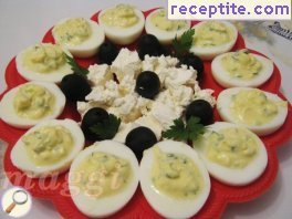 Stuffed eggs with feta cheese and cucumber