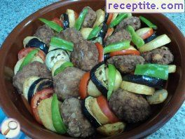 Potatoes with meatballs in the oven