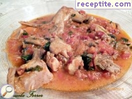 Rabbit with tomatoes, mushrooms and rosemary