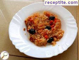 Rice with tomatoes and olives in the oven