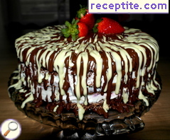 Juicy layered cake with chocolate, strawberries and cream