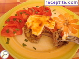 Lazy meat in French with mushrooms and tomatoes