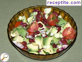 Salad of beans, avocado, cucumber and tomato