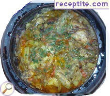 Stewed chicken with vegetables in a pot