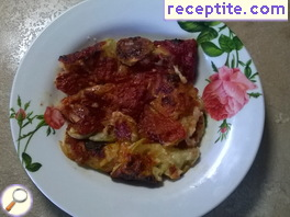 Baked zucchini with tomato sauce