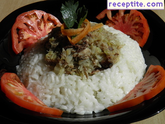 Smoked fish with fresh cabbage over rice