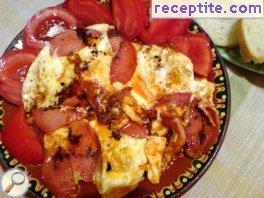 Poached eggs with sausage and cheese