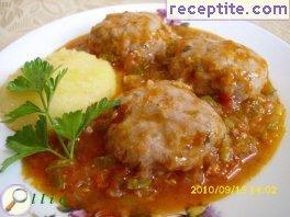 Meatballs with tomato sauce and roasted peppers