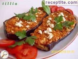 Stuffed eggplant with feta cheese and tomatoes