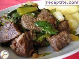 Lamb stew with onions and spinach