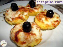 Stuffed baked potatoes with cheese