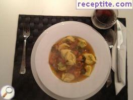 Vegetable soup with dumplings or ravioli