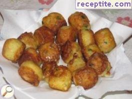 Potato balls with ham and cheese