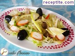 Green salad with crab sticks and capers