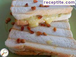 Sandwiches with pesto and pine nuts