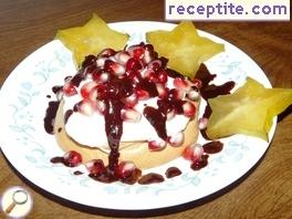 Mini Pavlova dessert with pomegranate