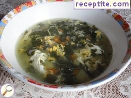 Spinach soup with eggs crossed