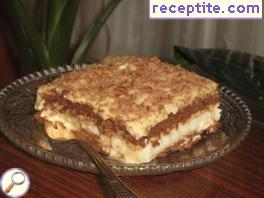 Biscuit layered cake with caramel-cream cream