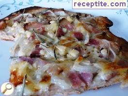 White pizza with bacon, Gorgonzola and rosemary
