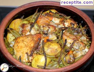 Chicken with vegetables in a pot